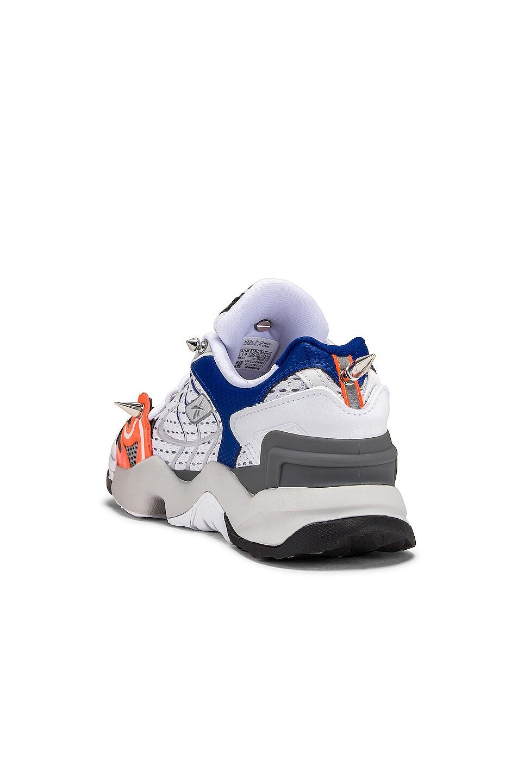 Image 3 of VETEMENTS Spike Runner 400 Sneakers in Fluo Orange
