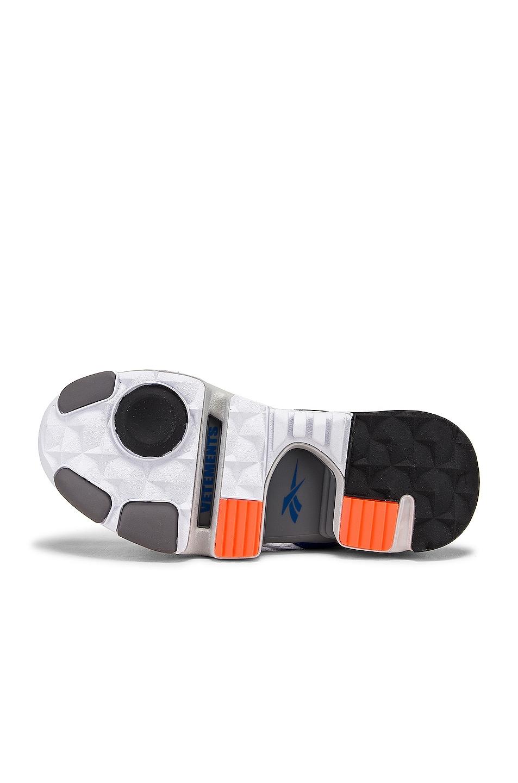 Image 6 of VETEMENTS Spike Runner 400 Sneakers in Fluo Orange