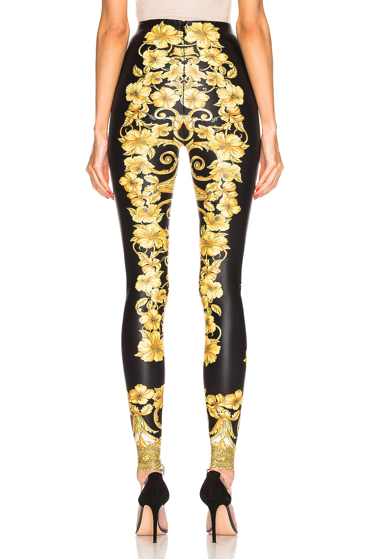 Image 3 of VERSACE Hibiscus Printed Leggings in Gold & Print
