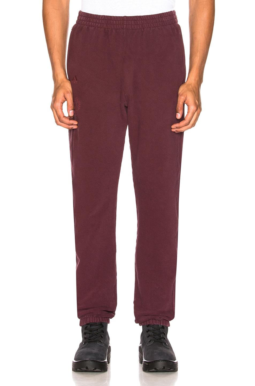 f4e97ec07 Image 1 of YEEZY Season 5 Calabasas Sweatpants in Oxblood
