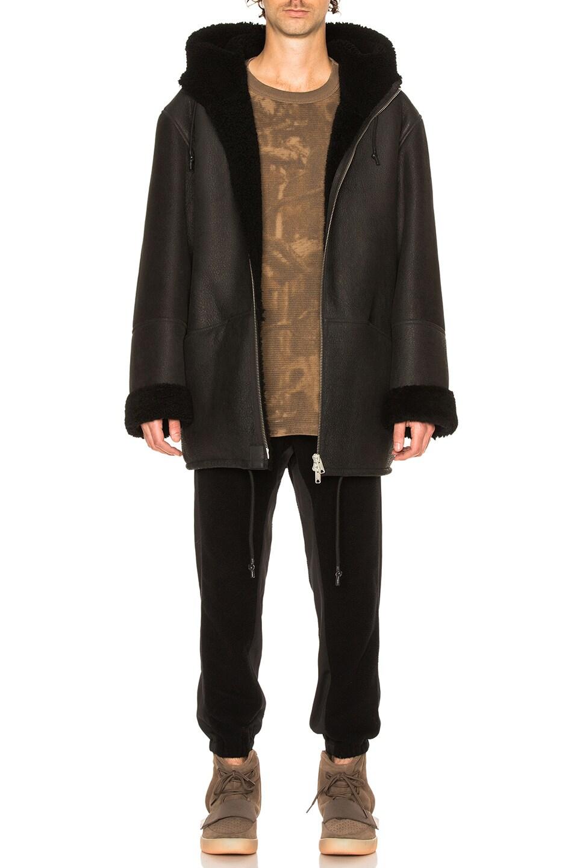 Image 1 of YEEZY Season 3 Hooded Shearling Jacket in True Onyx