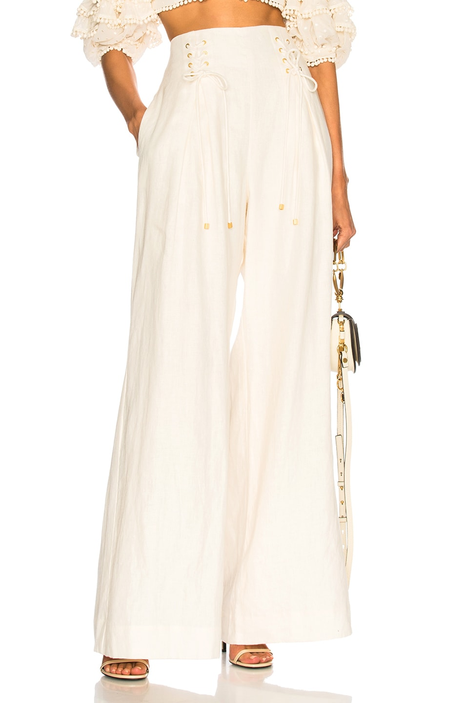83734a58829 Image 1 of Zimmermann Painted Heart Lace Up Pants in Cream