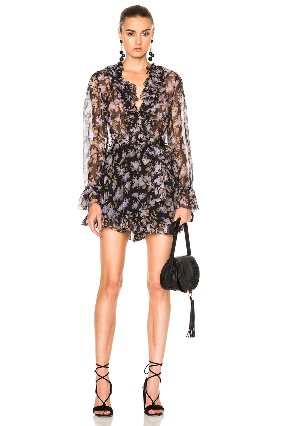 80e781416e9 Image 1 of Zimmermann Stranded Ruffle Playsuit in Black Lavender Floral