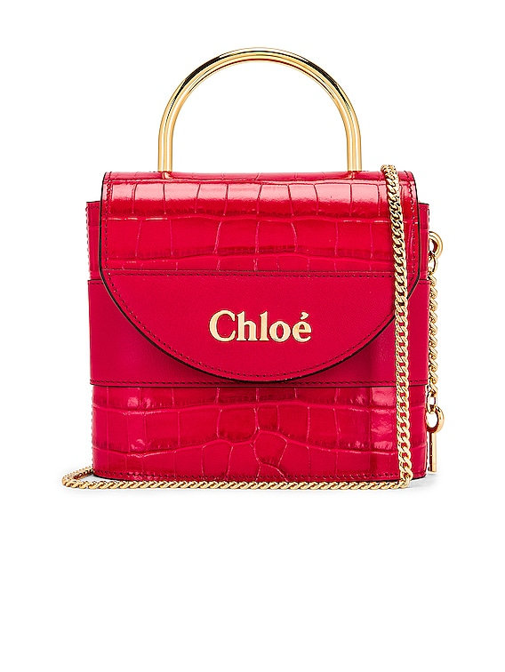 Small Abylock Embossed Croc Padlock Bag in Crimson Pink
